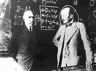 Max Planck and Niels Bohr in front of Maxwell's equations
